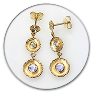 Earrings with faceted moonstone and brilliants in 18k gold