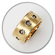 Ring from 18k gold and charred 925 silver with  brilliants