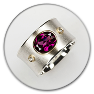 Ring from 925 silver with rhodolith and two brilliants set in 18k gold