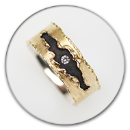 Ring from 18k gold and charred 925 silver with brilliant