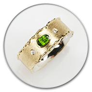 Ring from 18k gold and 925 silver with chromdiopsid and two brilliants