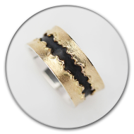 Ring from 18k gold and charred 925 silver