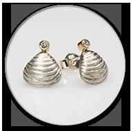 Muschelohrstecker aus 925 Silber mit Brillanten gefasst in 750 Gelbgold