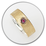 Ring from 18k gold and charred 925 silver with ruby