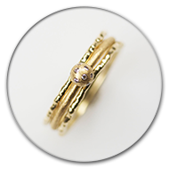 Three interlocked rings from 18k gold with small brilliants in gold sphere