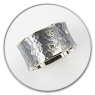 Blackened and hammered ring from 925 silver with set in brilliants