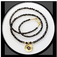 Fantastisch funkelnde schwarze Diamantkette mit 750 Gelbgold, geschwaerztem 925 Silber und Brillant<br />